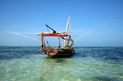Antique Fishing Boat. Old-Fashioned boat sitting in the shallow waters off of Zanzibar Royalty Free Stock Photo