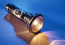Antique flashlight. An antique flashlight glowing while on Stock Images