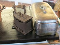 antique flat iron above the old kitchen stove Royalty Free Stock Photos
