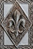 Antique Fleur-de-lis on Tile. I royalty free stock photos