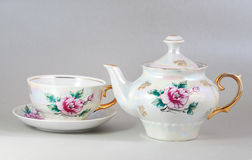 Antique floral porcelain tea pot and cup Stock Image