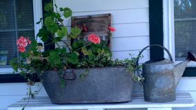 Antique flower box and watering can Royalty Free Stock Photos