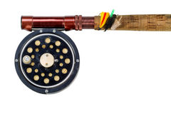 Antique fly reel and rod on white background Stock Photos