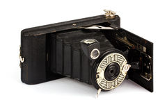 Antique fold away camera on white Royalty Free Stock Images