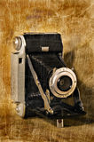 Antique Folding Camera with Grunge Texture Stock Photo