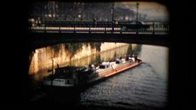 Antique footage of a river barge carrying cargo stock video footage