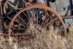Antique forgotten combin rusty wheel Stock Photos