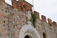 Antique fortified wall and gate in Pisa Royalty Free Stock Photos
