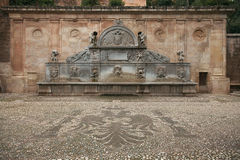Antique fountain near the Alhambra, Granada, Spain Stock Photos