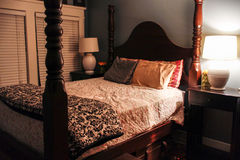 Antique four-post queen size bed. With quilt Stock Photos