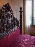 Antique four-poster bed with headboards carved inside Villa dei. Torreglia, Italy - May 26, 2018: Antique four-poster bed with headboards carved inside Villa dei Royalty Free Stock Photos