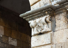 Antique fragment in a medieval roman building. Spain Stock Photos
