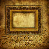 Antique frame. Antique blank frame over old wall Royalty Free Stock Image
