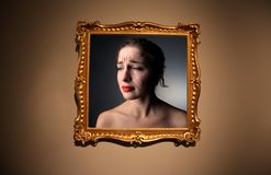 Antique frame. Portrait of a crying woman in antique frame Stock Photography