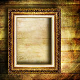Antique frame. Antique blank frame over wooden wall Royalty Free Stock Photography