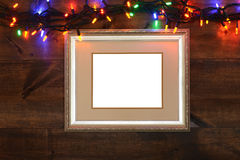 Antique frame with christmas lights Stock Image