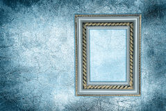 Antique frame on a frozen wall Stock Images