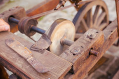 Antique frame with grinding wheel for sharpening knives in medieval times. Royalty Free Stock Photo