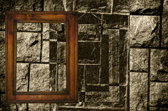 Antique frame on stonewall. Royalty Free Stock Image