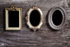 Antique frame on wood Royalty Free Stock Photo