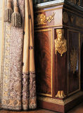 Versailles, France - 10 August 2014 : Antique French furniture inlaid with gold at Versailles Palace ( Chateau de Versailles ) Royalty Free Stock Image