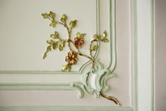 Antique fretwork ornament on palace wall. Colorful floral ornament decoration on wall of a noble villa Stock Photo