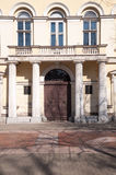 The antique front door with antique poles Stock Photo