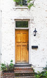 Antique Front Door and Flower Bed Stock Photos