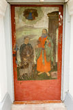 Antique front door with painted picture Stock Images