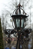 Antique frosty lamppost and beautiful snow covered branches agai. Nst the azure sky Stock Image