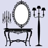 Antique furniture. Interior scene with antique furniture, old mirror, candelabra and console Stock Photo