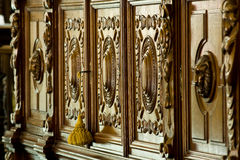 Antique furniture. Ornate antique wooden furniture in a hotel Stock Photos