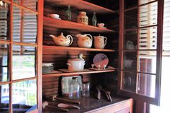 Antique furniture & dishes Stock Image