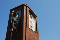 Antique Gas Pump. Antique weathered gas pump against blue sky Royalty Free Stock Images
