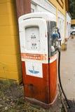 Antique gas pump near garage, Jackson, Wyoming. Stock Photo