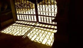 antique gate shadows Στοκ Φωτογραφίες