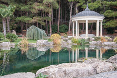 Antique gazebo in  park near a pond. Antique gazebo in a park near a pond in high quality Royalty Free Stock Photo