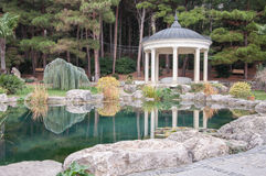 Antique gazebo in park near a pond Royalty Free Stock Image