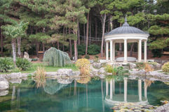 Antique gazebo in park near a pond Stock Images