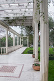 Antique gazebo in a park surrounded by the southern plants. In high quality Royalty Free Stock Images