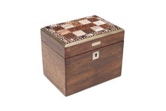 An Antique General Purpose Wooden Box with Lock. A cut-out of a vintage wooden box with link and lid covered in ornamental tiles stock images