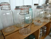 Antique glassware, Ball canning jars with lightening lids Stock Photo