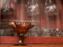 Antique Glassware Display. Various antique glassware pieces displayed in an antique hutch Royalty Free Stock Photography