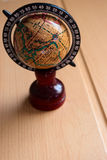 Antique globe. Small decorative antique globe stands on the table Royalty Free Stock Images