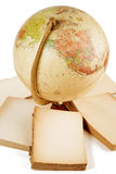 Antique globe and blank books Royalty Free Stock Photo