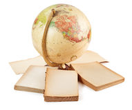 Antique globe and blank books Royalty Free Stock Images