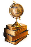 Antique globe on books royalty free stock photography