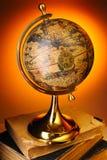 Antique globe on books Royalty Free Stock Photos