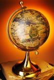 Antique globe on books Stock Photos