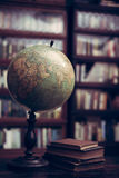 Antique globe and books Stock Images